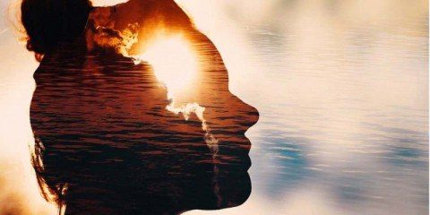 sun-peeks-out-from-behind-the-clouds-in-womans-head-picture-id1197670670