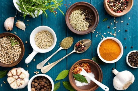 culinary-background-with-spices-on-wooden-table-picture-id544598354