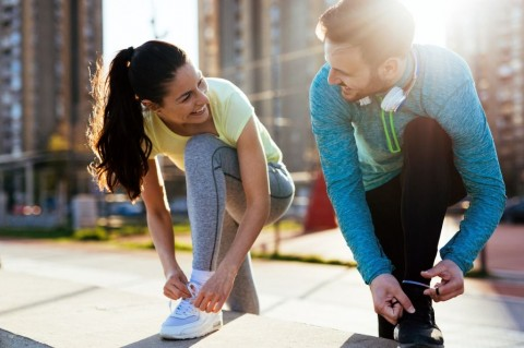 runners-tying-running-shoes-and-getting-ready-to-run-picture-id864384892