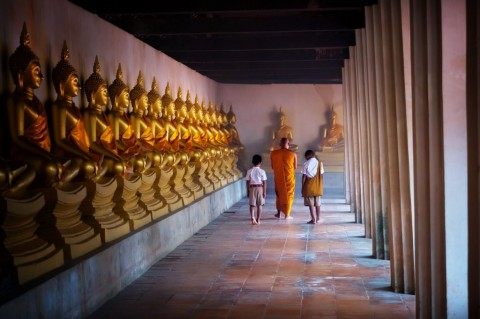 monk-and-tow-boy-student-at-golden-buddha-statue-makhabucha-day-way-picture-id917774308