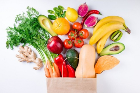 healthy-food-background-healthy-food-in-paper-bag-fruits-and-on-picture-id937808604