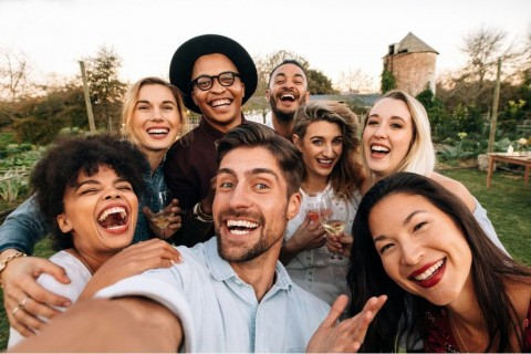 friends-making-a-selfie-together-at-party-picture-id903724814
