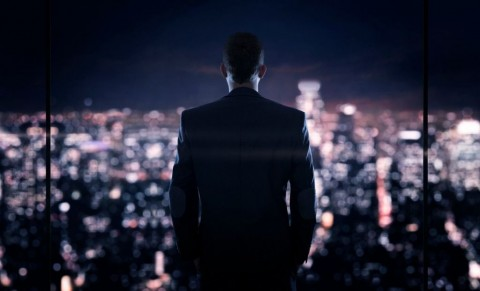 businessman-looking-at-the-the-city-at-night-picture-id516134582