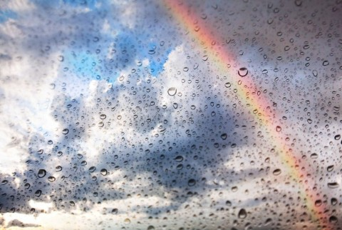 rainbow-and-water-drops-on-glass-texture-picture-id153517484