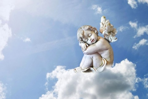 little-angel-sleeping-on-the-cloud-picture-id625379382