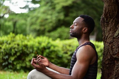 young-man-meditating-picture-id961344078