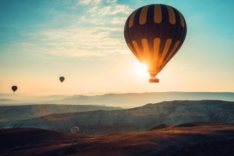hot-air-balloons-flying-over-the-valley-at-cappadocia-turkey-picture-id926425076