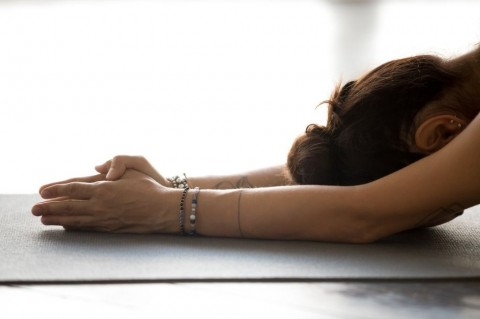 young-woman-practicing-yoga-doing-meditation-exercise-picture-id1046581322