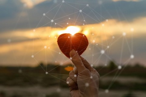 hand-holding-red-knit-heart-picture-id1147909478