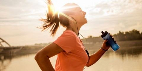 young-woman-running-against-morning-sun-picture-id1182436440