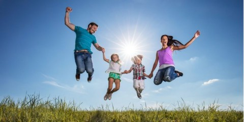 happy-family-holding-hands-and-jumping-against-the-sky-picture-id543084146-1