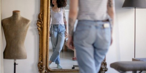 reflection-of-young-tattooed-woman-in-the-mirror-picture-id1148990473