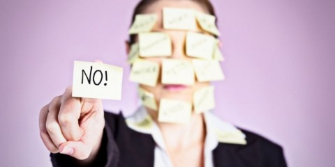 woman-obscured-by-adhesive-notes-holds-out-message-saying-no-picture-id181049594
