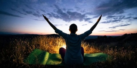 relax-and-go-back-to-nature-yoga-at-night-solo-traveler-a-cheerful-picture-id1258126268