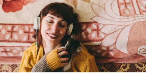 relaxed-girl-with-cat-enjoying-good-music-at-home-picture-id1137032009