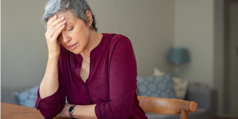 stressed-senior-woman-at-home-picture-id1044148964