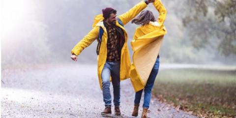 happy-couple-in-raincoats-
