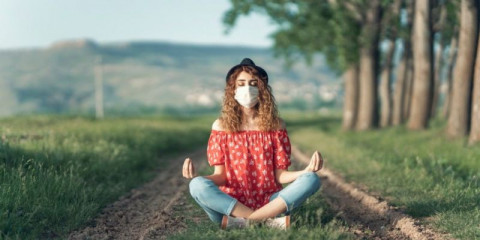 woman-wearing-medical-face-mask-during-yoga-meditation-exercise-picture-id1225452303