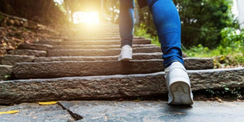young-woman-walking-up-the-old-stone-stairs-picture-id1265440694