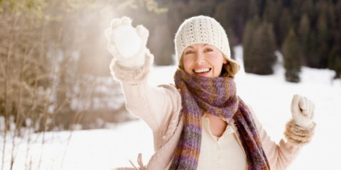 woman-holding-snowball-picture-id102284322