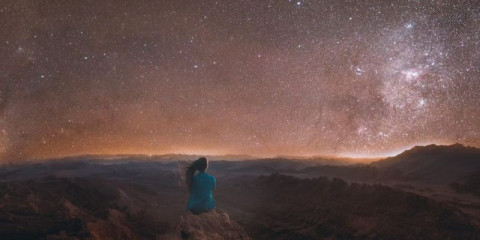 woman-enjoying-the-scenic-view-of-the-million-stars-above-the-big-at-picture-id1214291502