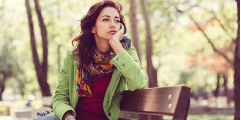 unhappy-girl-sitting-at-bench-picture-id639794440