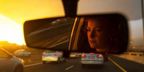 woman-driver-stuck-in-traffic-picture-id696636446