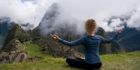 peaceful-woman-meditating-in-machu-picchu